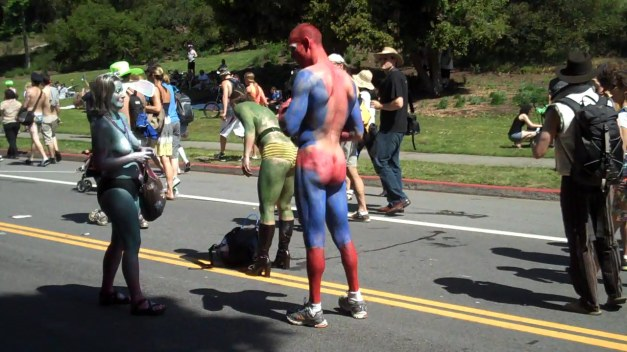 Naked Spiderman (except for shoes and body paint) and two female assistants take a break during  the Bay to Breakers race.