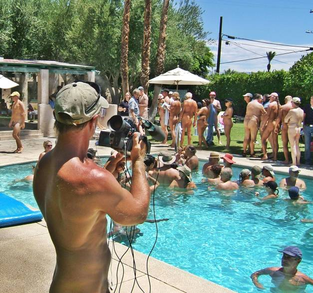 Things to do Nude Camera Crew filming as people sign in that they were participants.